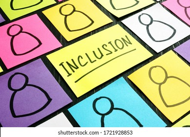 Inclusion sign and sheets with drawn of figures of people.