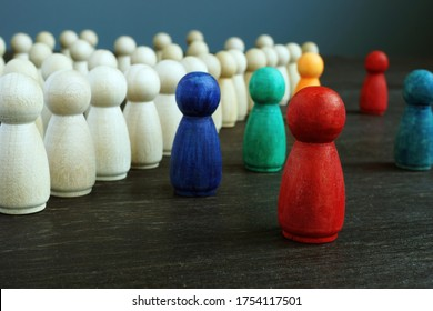 Inclusive and discrimination concept. Lines of wooden figurines and different ones as symbol of diversity.