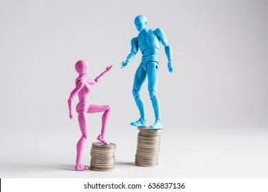 Income inequality concept shown with realistic male and female figurines and piles of coins