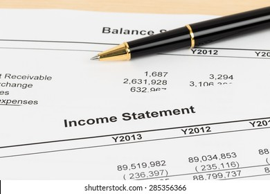 Income statement financial report with pen