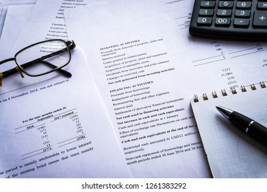 Income Statement report with calculator, document is mock-up