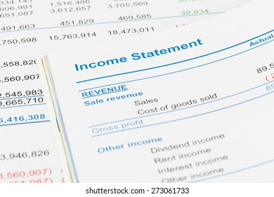 Income Statement report with pen; document is mock-up