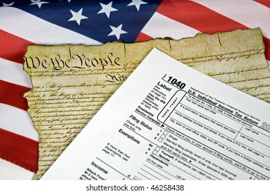 income tax form and U.S. Constitution on flag