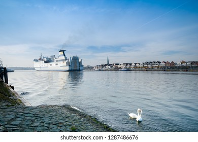 Lübeck-Travemünde with incoming ferry and swans in the foregro