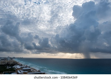 Incoming rain funnel over Cancun ocean