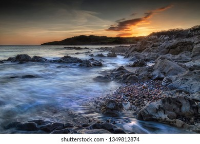 Incoming sea on the beautiful rocky coastline of Rotherslade Bay, a small bay in South Gower next to the more famous Langland Bay in Swansea, South Wales, UK