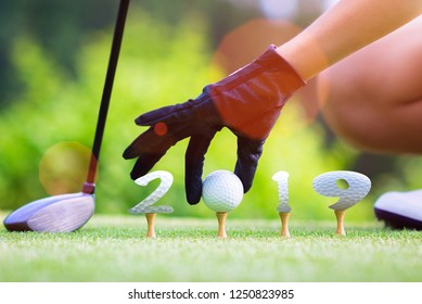 incoming year 2019, prepare by hand of woman golfer on the green,  golfball mostly ready to hit into the fairway of new year successfully, Happy new year and merry Christmas on golf course
