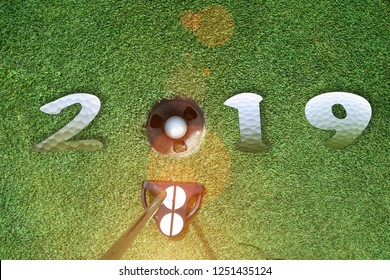 incoming year 2019, prepare by putting of golfer on the green,  golfball is ready dropped in hole of new year success, Happy new year and merry Christmas on golf course