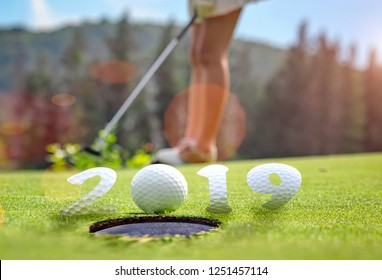 incomming year 2019, prepare by putting of woman golfer on the green,  golfball mostly ready to drop into the hole of new year success, Happy new year and merry Christmas on golf course