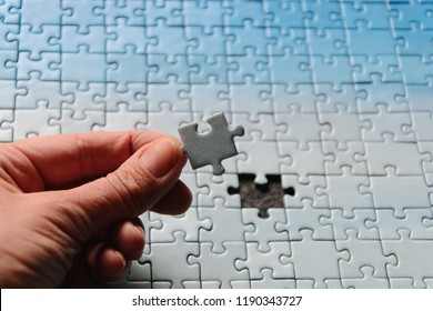 Incomplete jigsaw puzzles. Last piece, one element missing. Blue sky - always difficult in doing puzzles. Hard, difficult task. Perfect match, solution. Closeup, makro