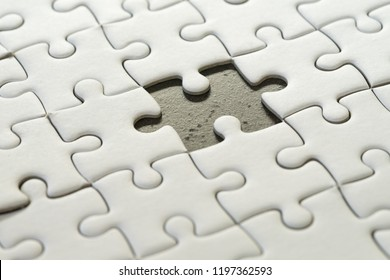 Incomplete, unfinished business strategy or finalize, problem solution metaphor, jigsaw puzzle with uncompleted missing piece.