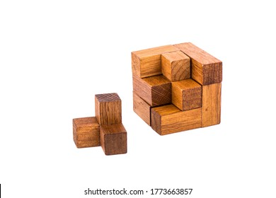 Incomplete wooden puzzle cube 7. Wooden puzzle consisting of 7 parts isolated on a white background. Copy space.