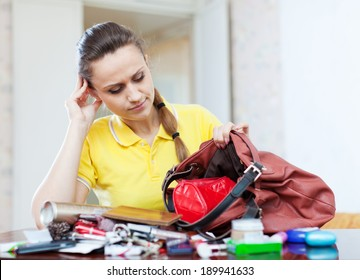 inconsiderate woman lost something and finding in handbag