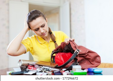 Inconsiderate woman lost something and looking in her purse