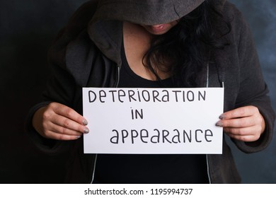 Inconvenience, overweight, shy, body shaming, weight loss. Unrecognizable woman hiding face worried and concerned about appearance deterioration. Beauty and health concept