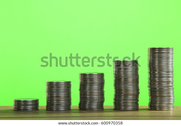 Increase columns of coins  on a green background
