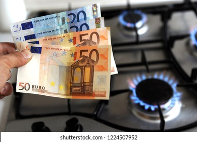 increase in the cost of the gas bill - euro money and gas stove turned on