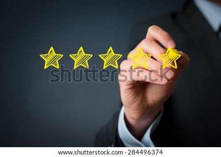 Increase rating, evaluation and classification concept. Businessman draw five yellow star to increase rating of his company.