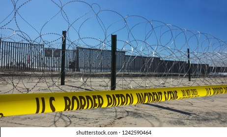 Increased fortifications and barbed wire at the border fence between San Diego and Tijuana after violent clashes with migrant caravan.