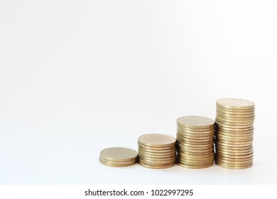 Increasing columns of gold coins isolated on white background.