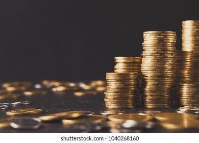 Increasing columns of gold coins on table, black background, copy space. Financial success, cryptocurrency mining, profit concept