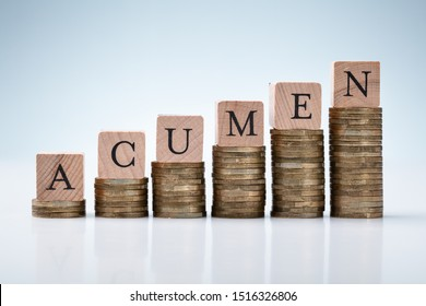 Increasing Graph Of Stacked Coins With Acumen Text Block On Reflective White Backdrop