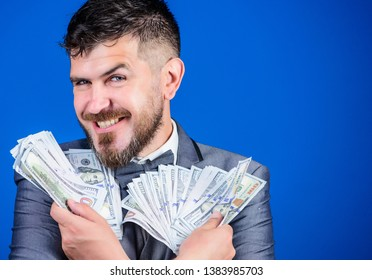 Increasing his cash income. Currency broker with bundle of money. Rich businessman with us dollars banknotes. Bearded man holding cash money. Making money with his own business. Business startup loan.