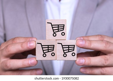 Increasing sales makes business successful, pyramid of cubes with a shopping cart icon and symbol.