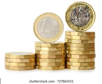 increasing stack of coins with one euro and one pound coin isolated on a white background