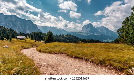 Incredible alpine highlands in summer in Dolomites Alps. Scenic image of famous Sassolungo peak. Splendid landscape in Val Gardena on sunny day. Gorgeous summer View of Alpine valley. Amazing nature