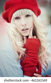 incredible blonde posing for the photographer in winter