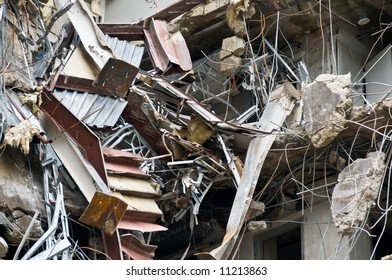 incredible building wreckage including hanging stairs, doorways, concrete, and rebar - part of series