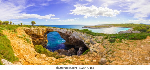 Incredible cave coastlline in Mallorca Beach Cala Varquez Panoramic View, Majorca Island with tropic turquoise sea water and tropical beach, Mediterranean Sea Spain