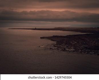 Incredible cinematic sunset in rocky beach near Easky Castle, Co.Sligo Ireland.