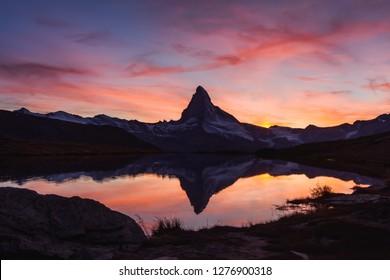 Incredible colorful sunset on Stellisee lake with Matterhorn Cervino peak in Swiss Alps. Zermatt resort location, Switzerland. Landscape photography