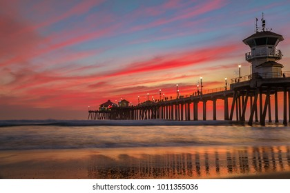 Incredible colors of sunset by Huntington Beach Pier, in the famous surf city in California