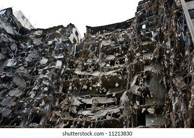 incredible demolition project - wrecked building shell on white - part of series