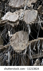 incredible detail of demolished concrete hanging from rebar - part of series