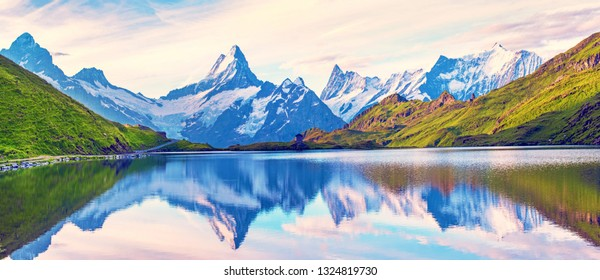 Incredible fascinating magical landscapel panorama with a lake in the mountains in the Swiss Alps. Wetterhorn, Schreckhorn, Finsteraarhorn et Bachsee. Charming places. Nature attractions.