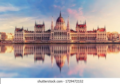 Incredible front view on Parliament building in Budapest with fantastic perfect sky and reflection in water. calm Danube river. Popular Travel destinations. creative image used as background.