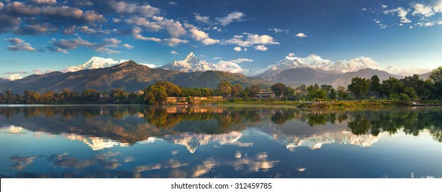 Incredible Himalayas. Panoramic view from the lakeside at the foothills of the magnificent Annapurna mountain range.