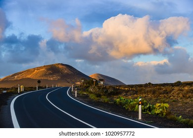 Incredible landscape on the island of Lanzarote with a road in the valley of La Geria. Canary Islands. Spain