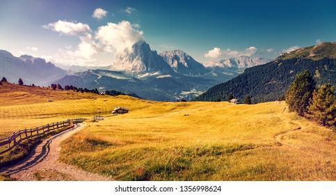 Incredible landscape in Val Gardena on a sunny day. Scenic image of famous Sassolungo peak. Amazing nature background.  Dolomiti, Trentino Alto Adige, province Bolzano, Italy, Europe.