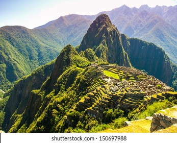 Incredible Machu Picchu in Peru - Inca citadel situated on a mountain ridge. One of Seven Wonders of the World and UNESCO World Heritage.
