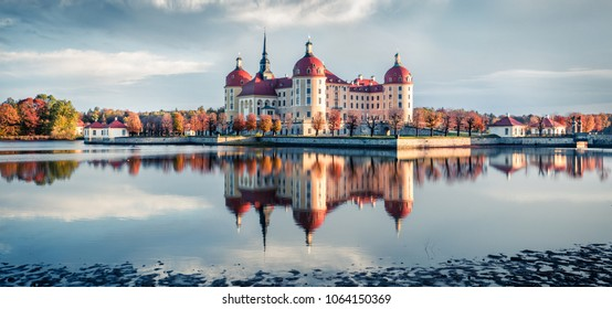 Incredible morning view of Moritzburg Baroque castke. Romantic autumn scene of Saxony, Dresden location, Germany, Europe. Traveling concept background. Instagram filter toned.