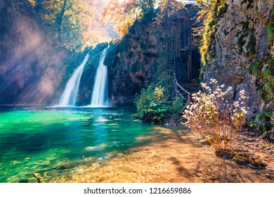 Incredible morning view of pure water waterfall in Plitvice National Park. Spectacular autumn scene of Croatia, Europe. Abandoned places of Plitvice lakes series. Beauty of nature concept background.
