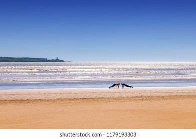 incredible Morocco, amazing Essaouira, a wonderful beach with people doing sports