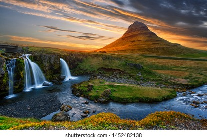 Incredible Nature landscape of Iceland. Fantastic picturesque sunset over Majestic Kirkjufell (Church mountain) and waterfalls. Kirkjufell mountain, Iceland. Famous travel locations. Creative image.