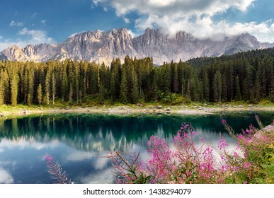 Incredible nature landscape.Sunny autumn day in Dolomites Alps. Lake Carezza with Mount Latemar, Bolzano province, South tyrol, Italy. popular travel locations. Picture of wild area