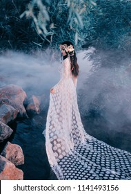 Incredible nymph, walks in the water in the middle of the river which was tightened by a thick, impenetrable fog. The mermaid has a white vintage, lacy dress. Feast of Ivan Kupala